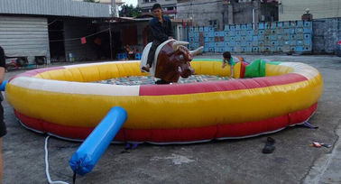 China Cool Inflatable Sports Games , PVC Material Inflatable Mat with Mechanical Bull supplier