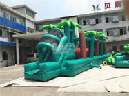 EN14960 Green Jungle Giant Inflatable Bouncer Obstacle Course With Rolling Wrecking Ball