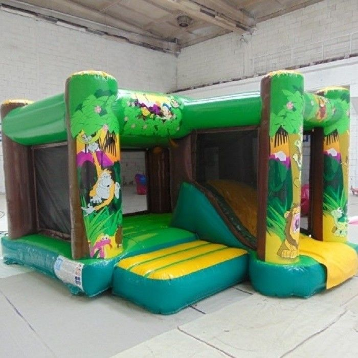 China Commercial Jungle Inflatable Combo 2 In 1 Combo Bounce House With Side factory