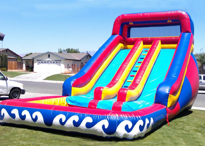 China Funny Wave Adult Size Giant Inflatable Water Slide With Pool factory