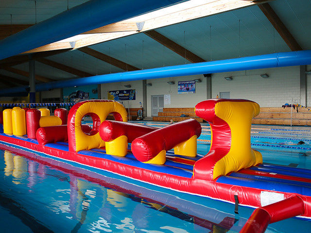 China 54 FT Long Giant Water Inflatable Obstacle Course With Slide Durable 0.9mm PVC factory