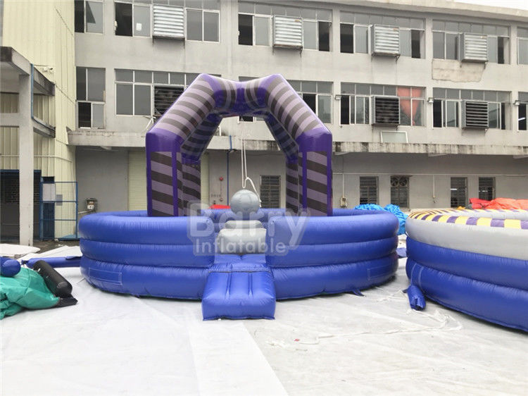 China Last Man Standing Inflatable Interactive Games , Purple Outdoor Playground Equipment Wrecking Ball Game factory